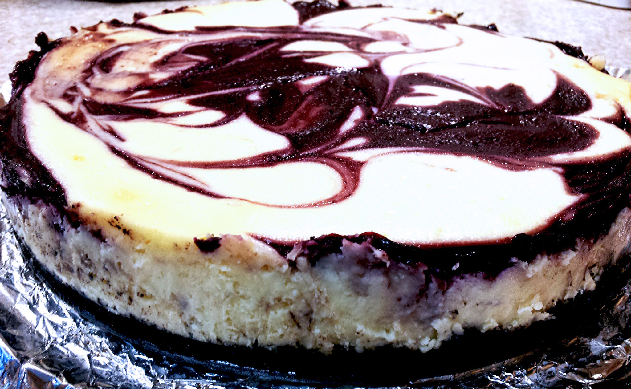 White Chocolate Raspberry Cheesecake with Oreo crust bake