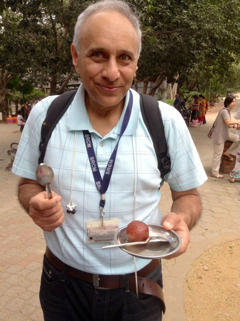 My dad enjoys a sattvic experience with his favorite dessert! And an extra spoon for me.